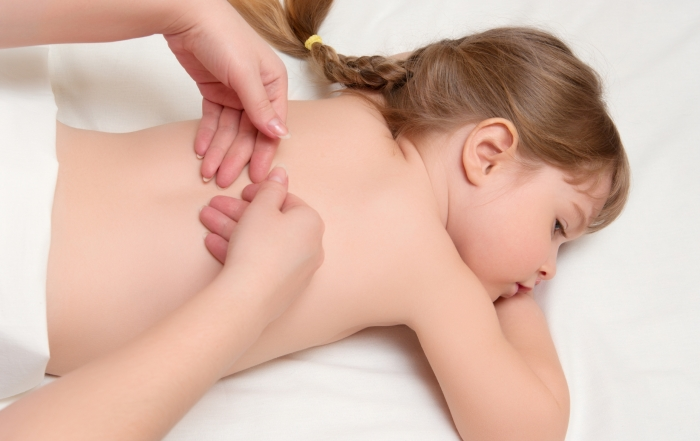 woman does massage to the little girlwoman does massage to lit